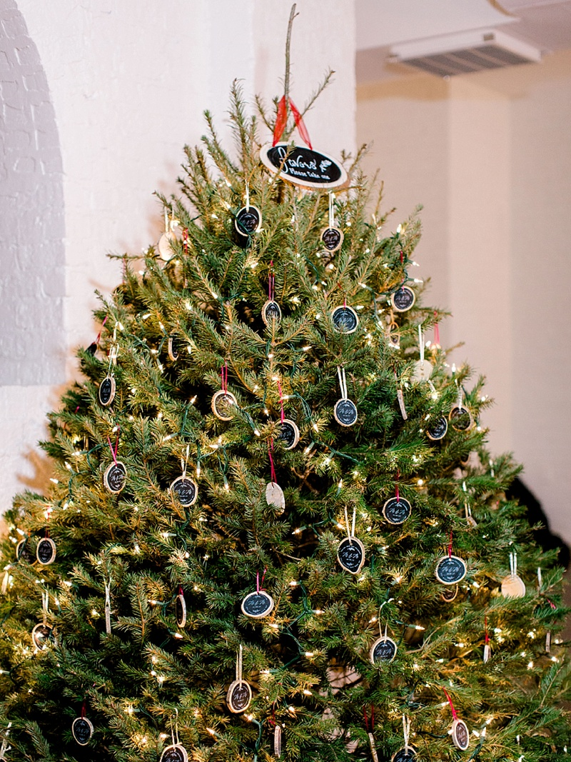 Twinkling Christmas tree decorated with Christmas ornament wedding favors
