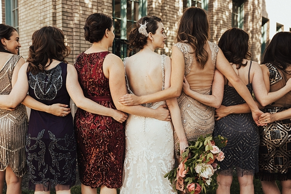 Mismatched Art Deco inspired bridesmaid dresses of all colors with sequins and sparkles