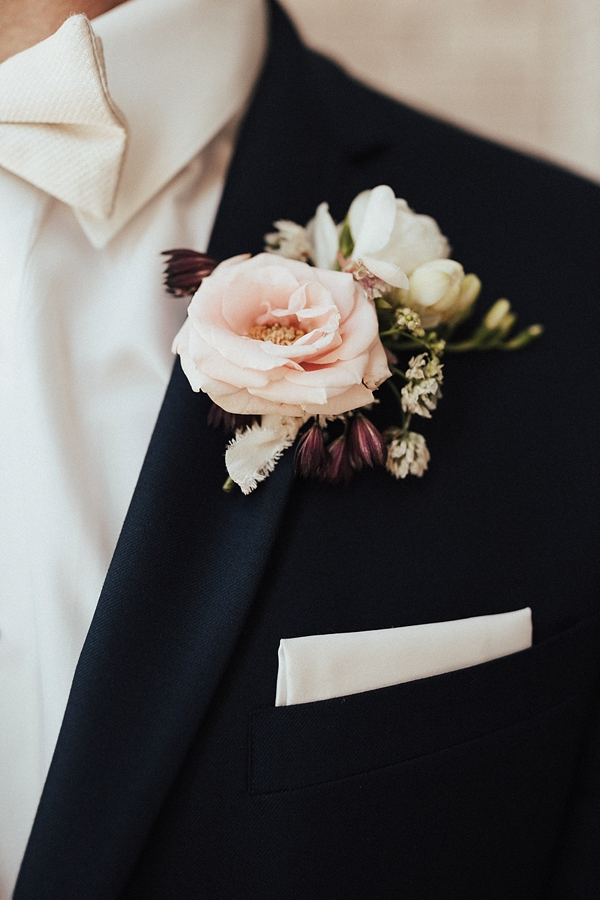 Vintage inspired wedding boutonniere with pink tea rose and frayed ribbon