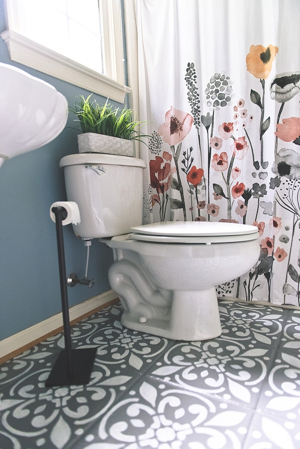 Modern and small budget bathroom upgrade ideas that include painting your ceramic floor tiles
