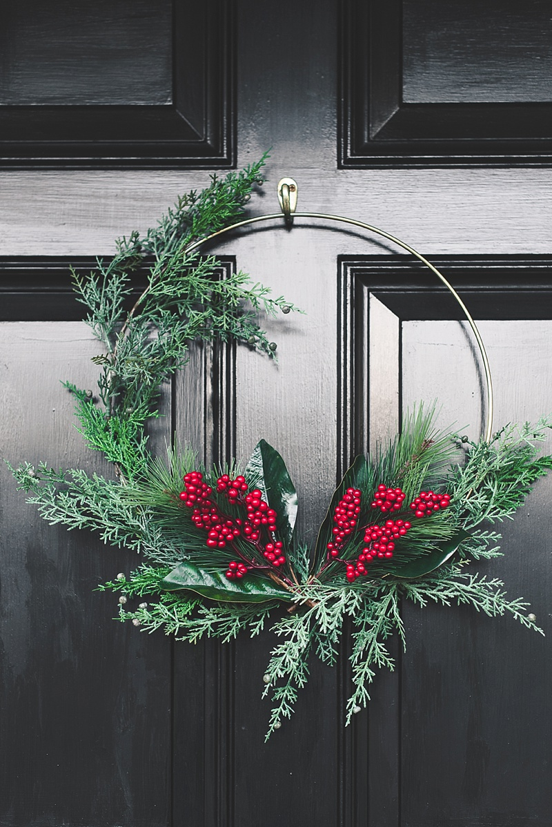 Gorgeous modern gold hoop Christmas wreath on a black door