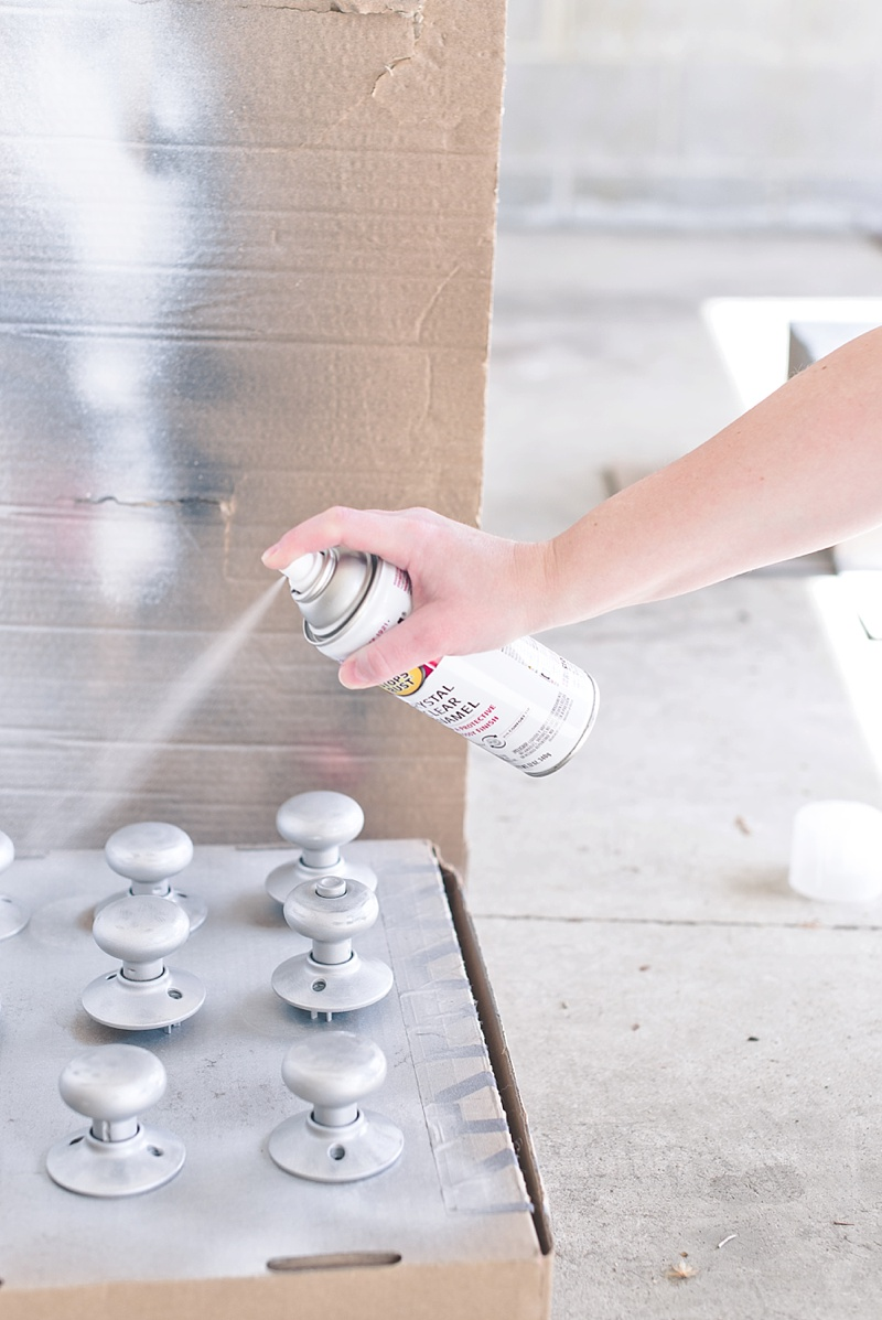 Finish spray painting door knobs with crystal clear gloss enamel for shiny finish