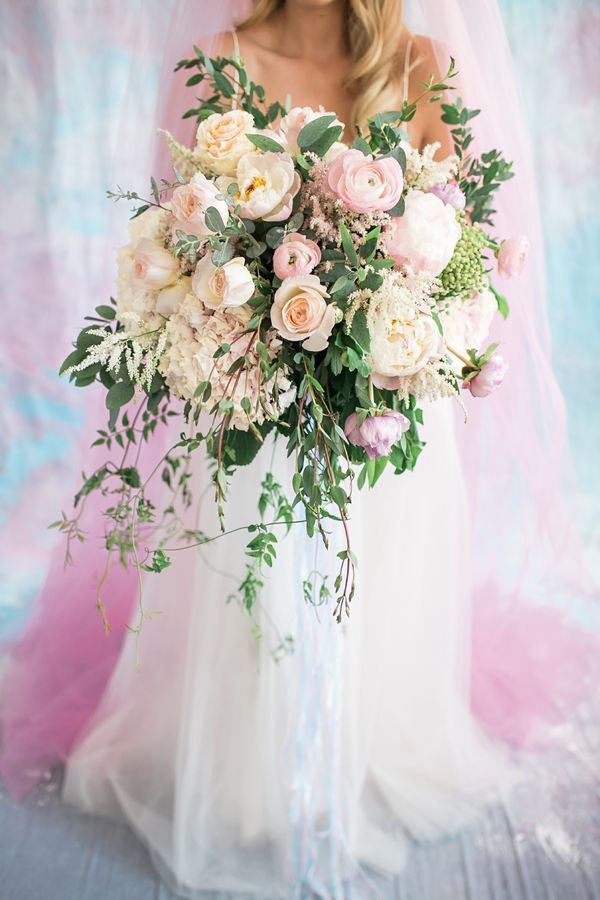 Pastel celestial wedding bouquet with iridescent ribbons
