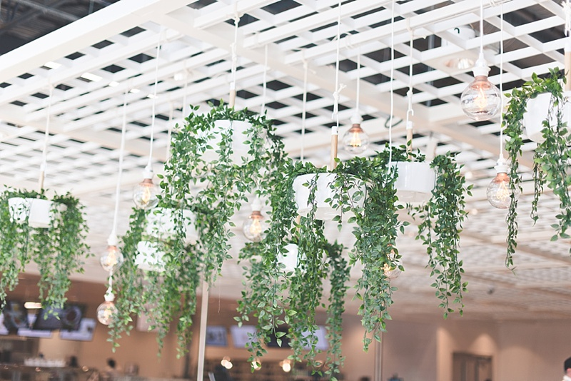 Draping FEJKA greenery for an IKEA wedding DIY decor