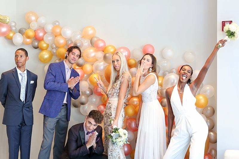 Fun modern balloon garland to look like champagne bubbles