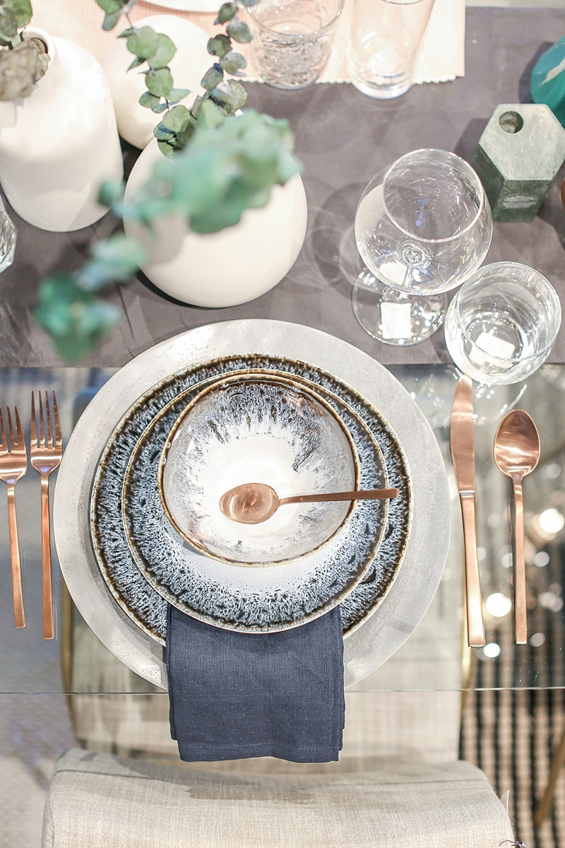 Ocean blue place setting with copper flatware for modern boho wedding