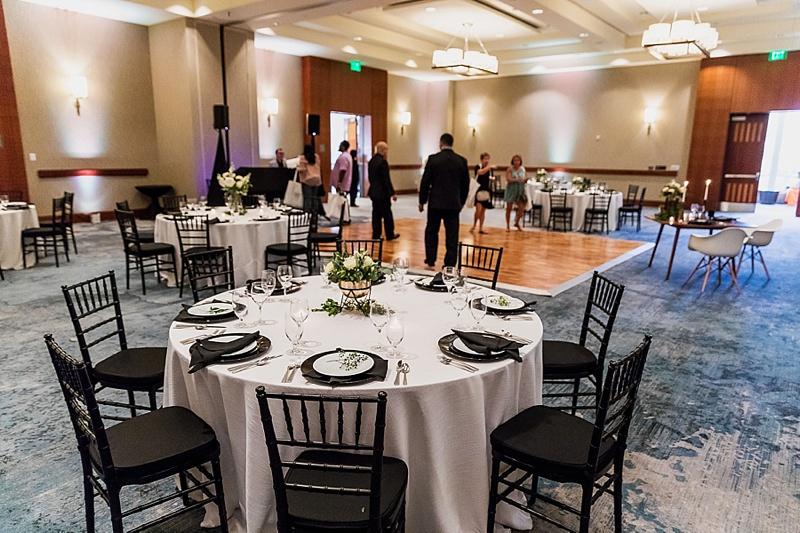 Black and white wedding reception with boho decor for a ballroom event