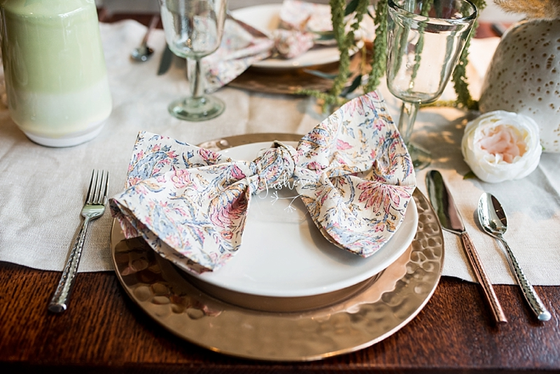 Pink patterned napkin from Pottery Barn with acrylic place card for modern boho post wedding brunch