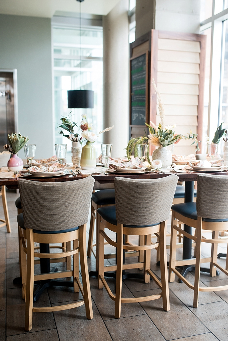 Modern boho post wedding brunch ideas with textured vases and copper chargers