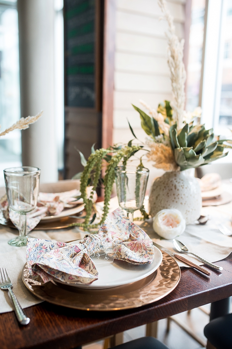 Chic modern boho post wedding brunch ideas with pampas grass and patterned pink protea napkins