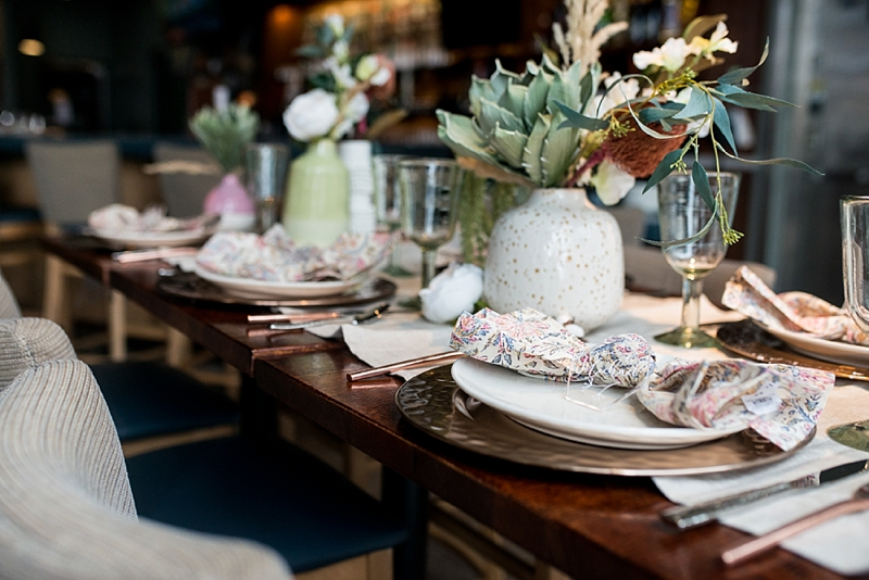 Modern boho post wedding brunch tablescape with pampas grass and dried pincushion protea