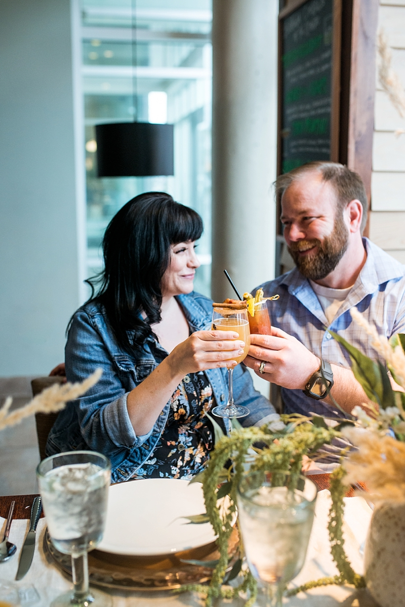 Bride and groom with signature mimosa cocktails at Tupelo Honey in Virginia Beach
