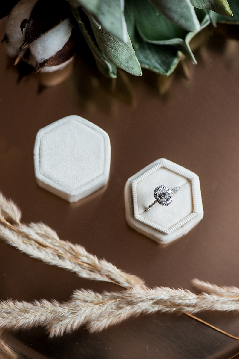 Beautiful oval engagement ring in cream colored velvet hexagon ring box