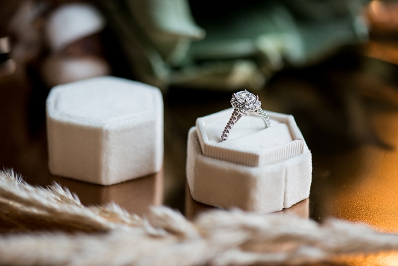 Oval wedding engagement ring with diamonds in the band