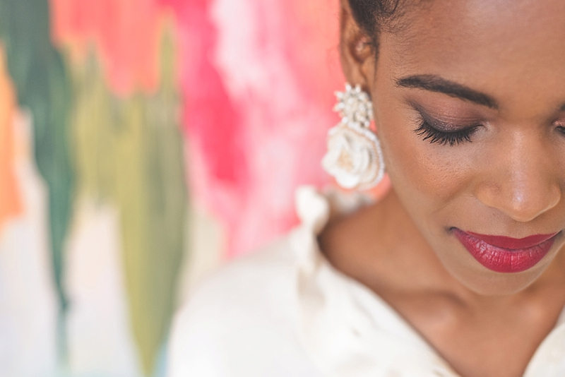 Romantic and elegant makeup look with bold red lip for black bride