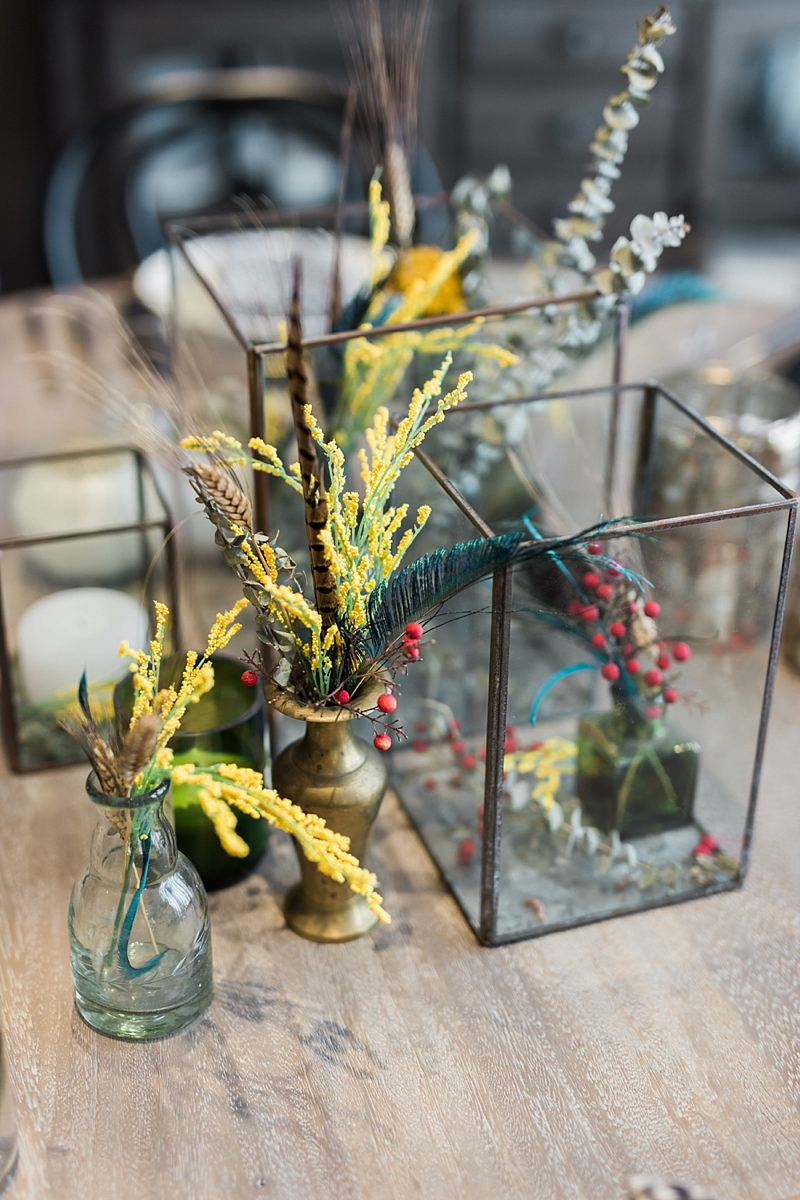 Rustic modern wedding centerpiece with pheasant feathers and unique dried botanicals