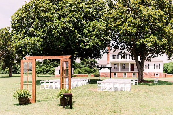 Outdoor wedding ceremony with glass doors for entrance
