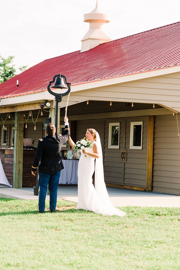 Bride and groom ringing the bell at Cousiac Manor in Virginia