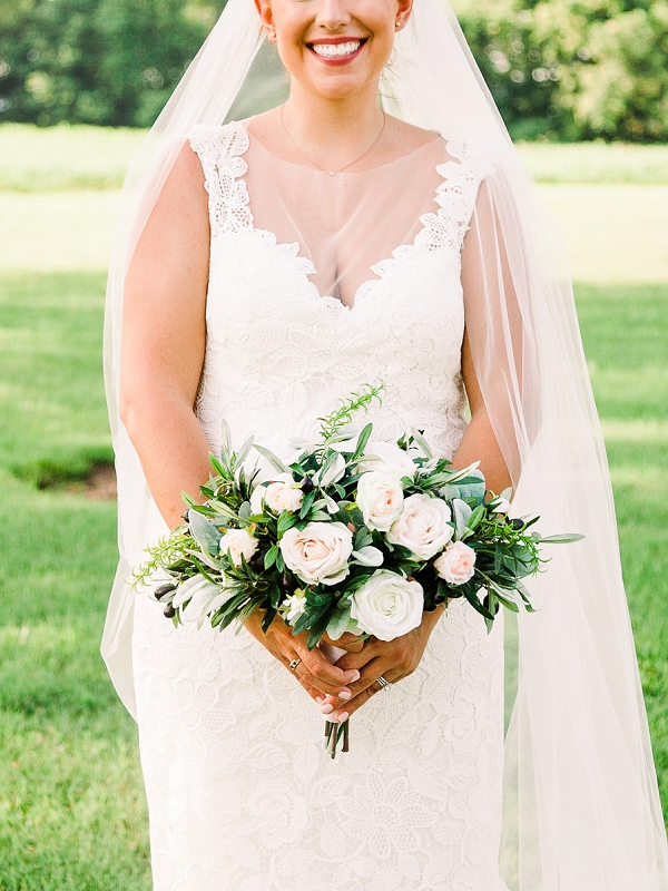 Simple white and pink wedding bouquet with rustic greenery
