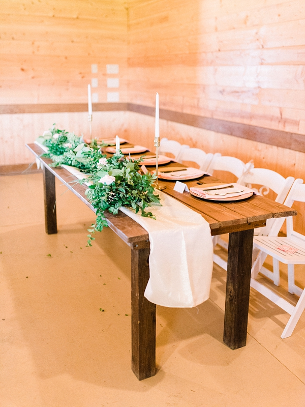 Wooden farm table for rustic barn wedding reception