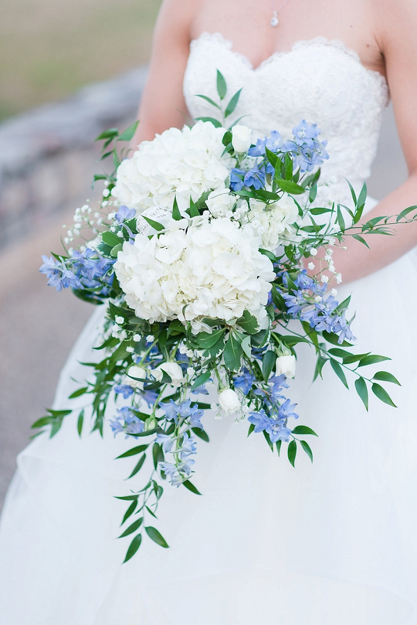 White and blue wedding bouquet with hydrangeas and italian ruscus