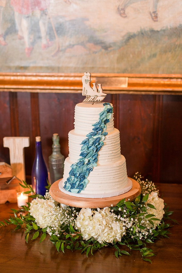 Blue and turquoise textured wedding cake with custom cake topper