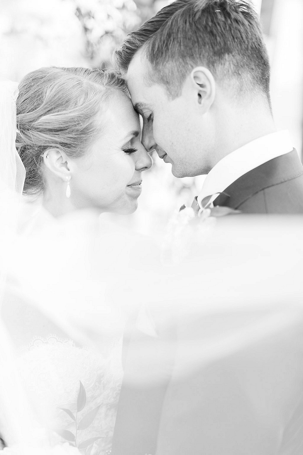 Sweet black and white photo moment with classic bride and groom