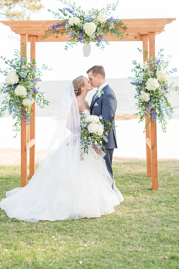 Nautical wedding ceremony arch with hydrangeas and greenery