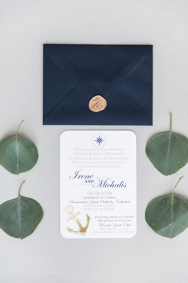 Navy blue and white nautical wedding invitation with gold anchor wax seal