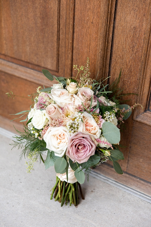 Pretty pink and white wedding bouquet with wax flowers and roses
