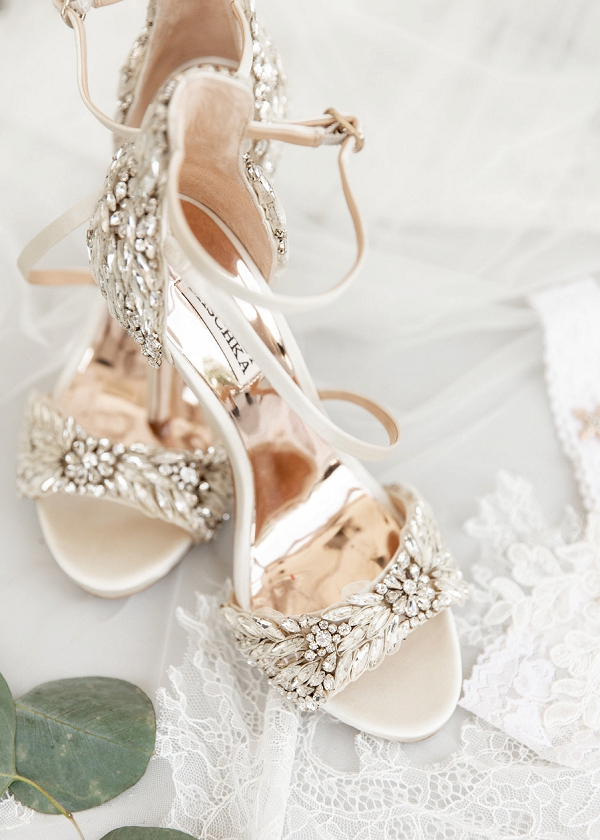 Bejeweled white and crystal bridal shoes by Badgley Mischka