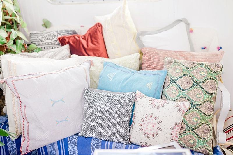 Eclectic mix of throw pillows for fun boho houseboat AirBnb