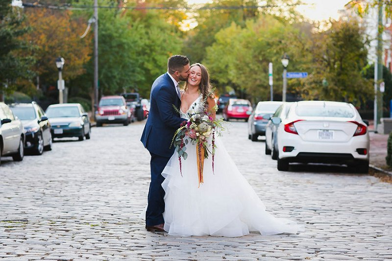 Beautiful bride and groom on the cobblestone streets of Norfolk Virginia