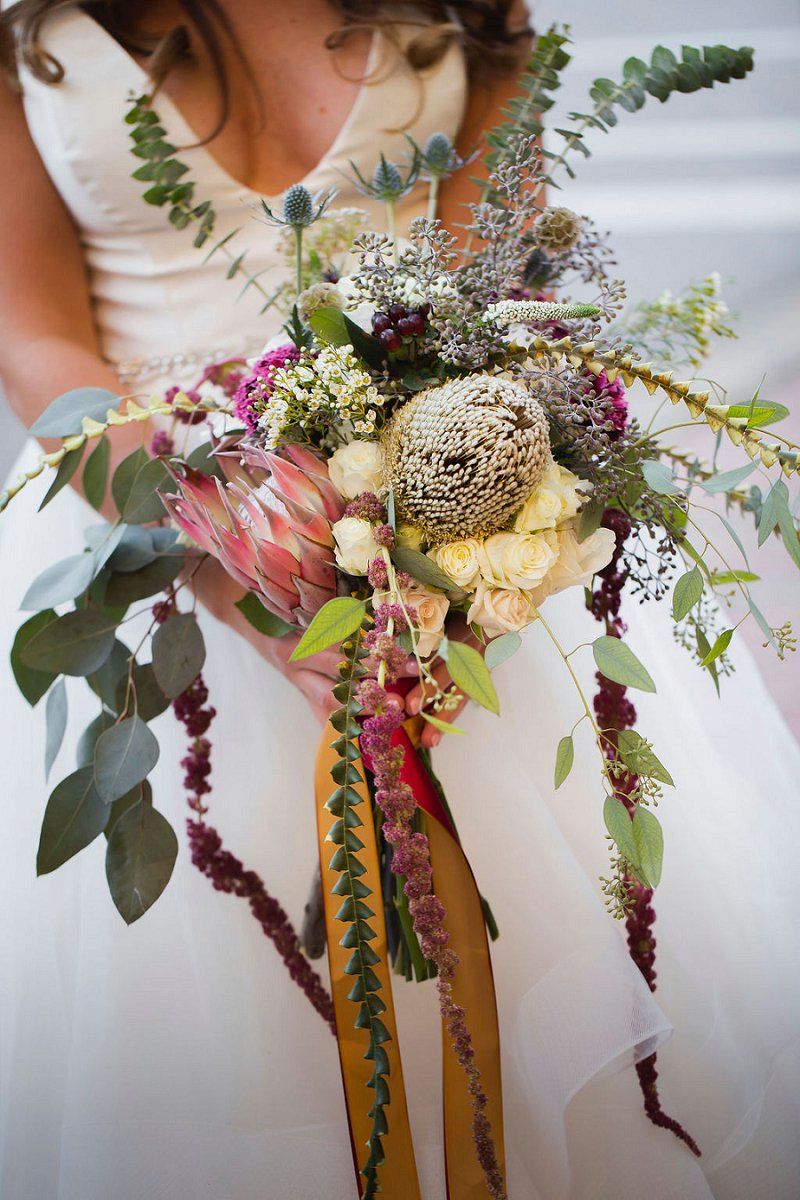 Boho bridal bouquet with protea and eucalyptus