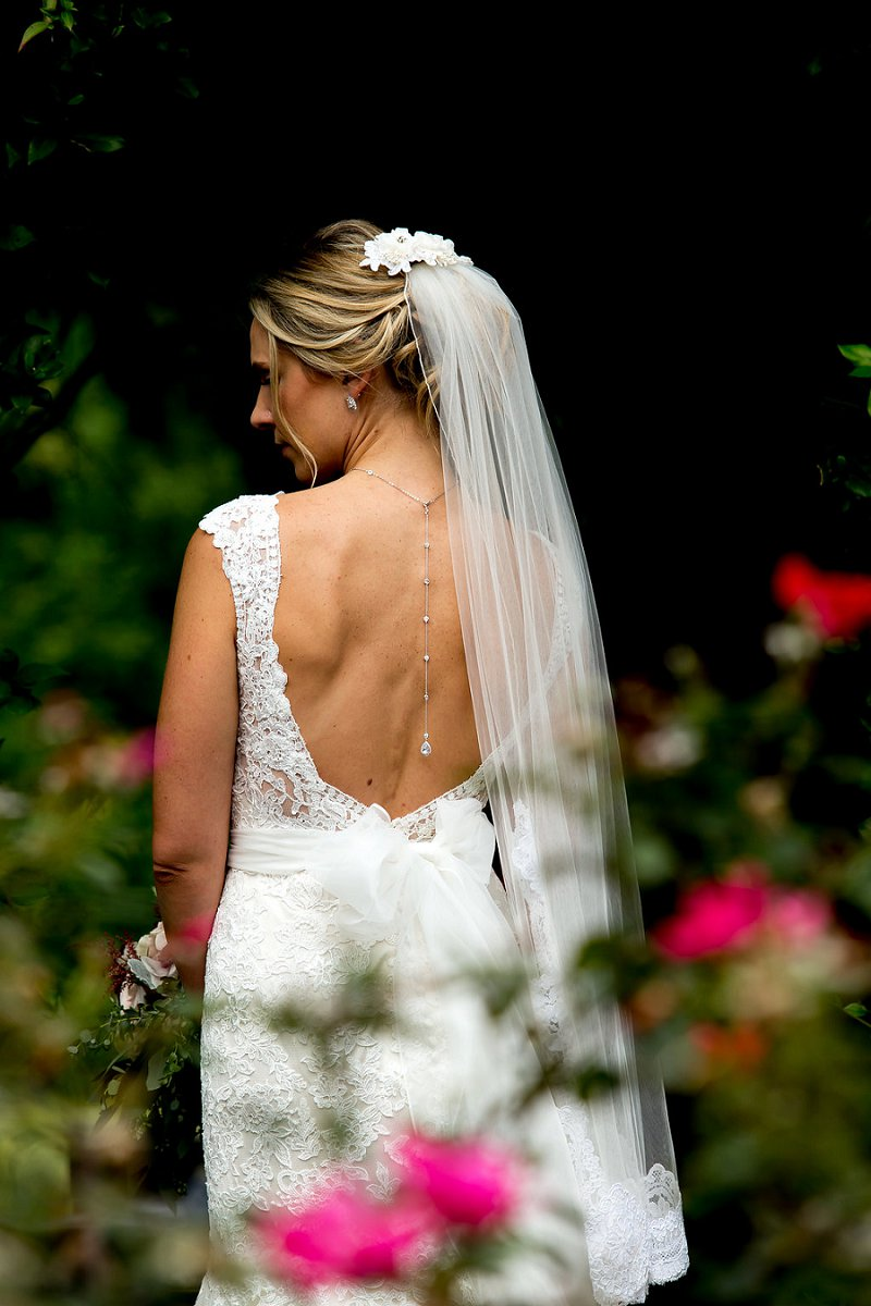 Delicate bridal necklace that drapes down the back with a low back lace wedding gown
