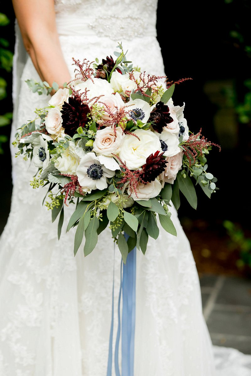 Textured wedding bouquet with anenomes and dark red dahlias