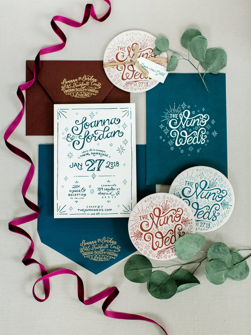 Handlettered and handmade wedding invitations in navy blue and burgundy red