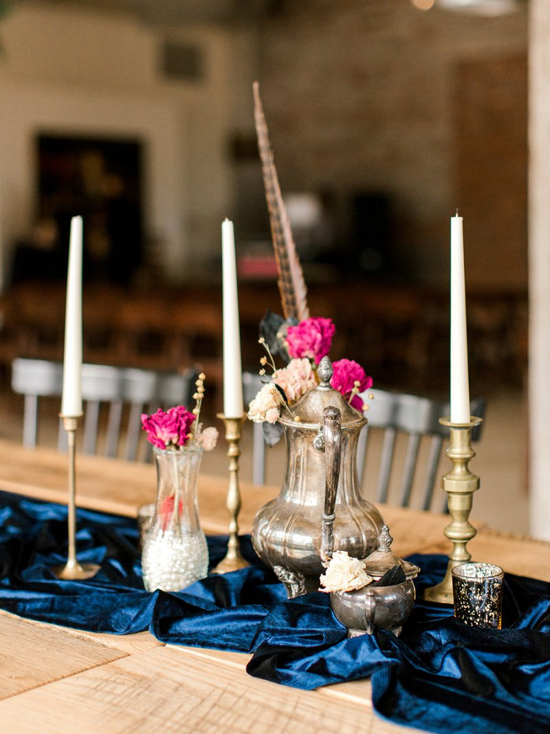 Eclectic vintage centerpieces with dried flowers and rich blue velvet table runners and gold candlesticks