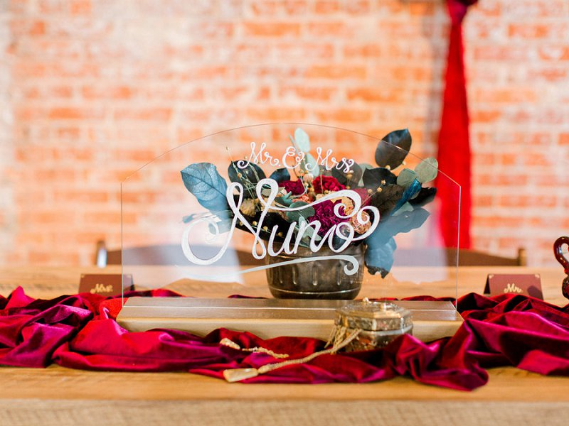 Acrylic wedding signage for sweetheart table with white calligraphy