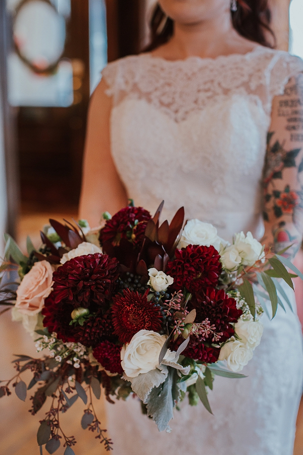 Dark red bridal bouquet with eucalyptus and roses