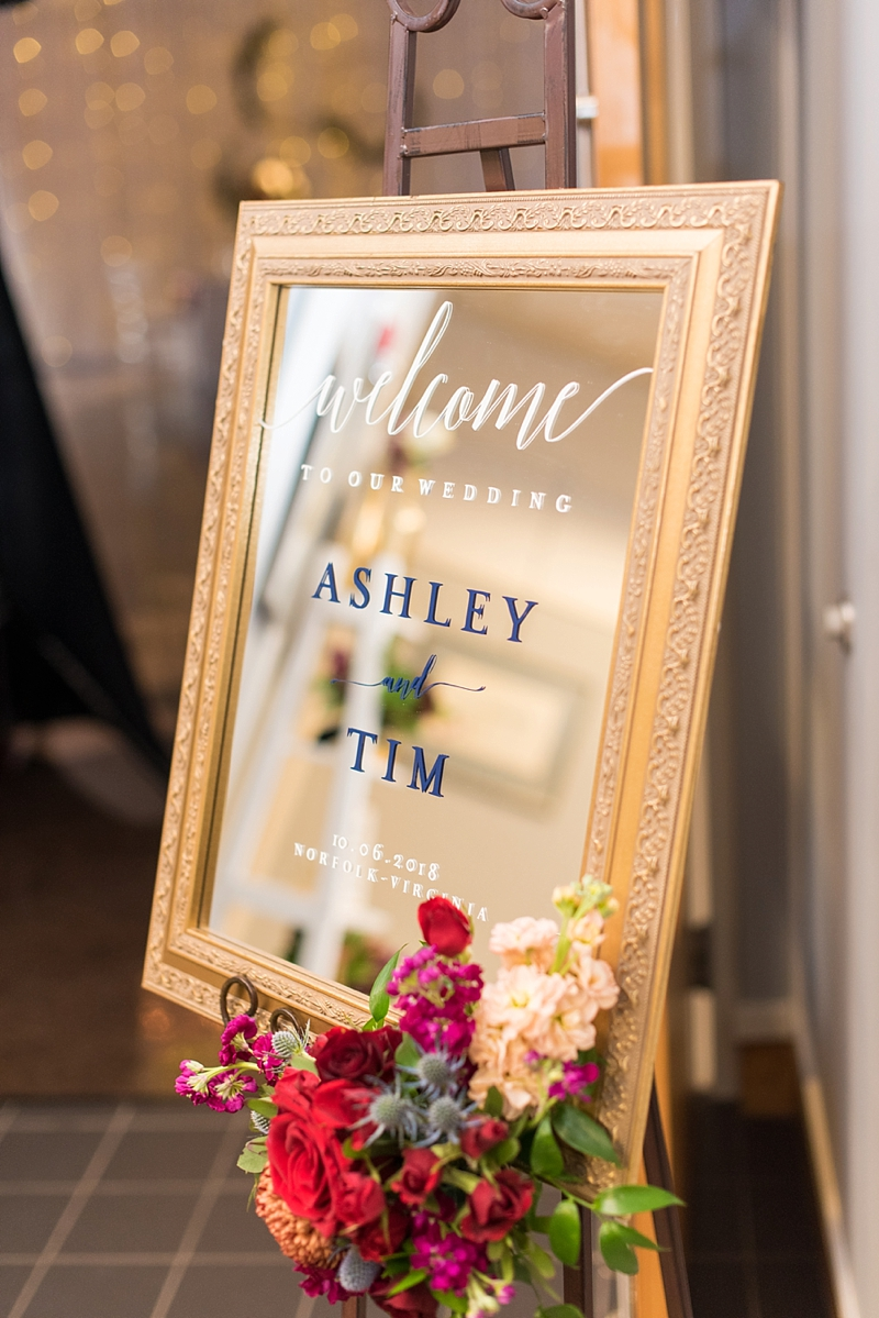 Handmade wedding welcome sign on a gold framed mirror made with Cricut machine