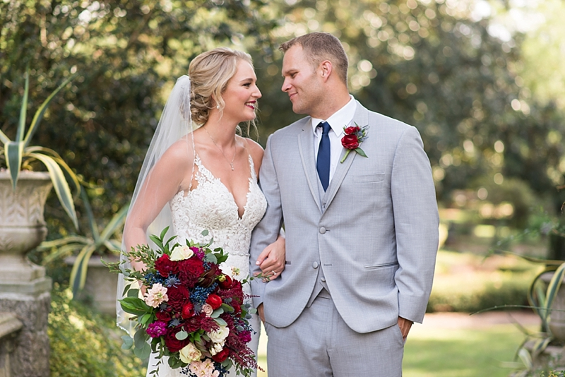 Romantic garden wedding at Norfolk Botanical Garden in Virginia with navy blue and red color palette