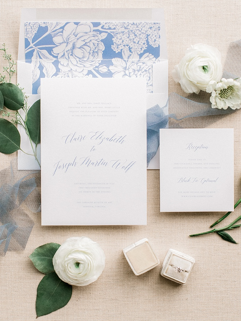 Classic periwinkle blue and white flower wedding invitation suite with elegant calligraphy and unique envelope liner