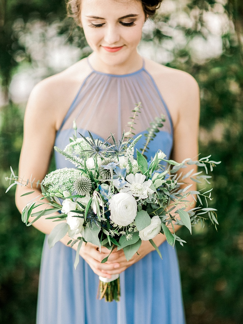 Sage green and blue and white bridesmaid wedding bouquet with blue thistle and ranunculus and greenery