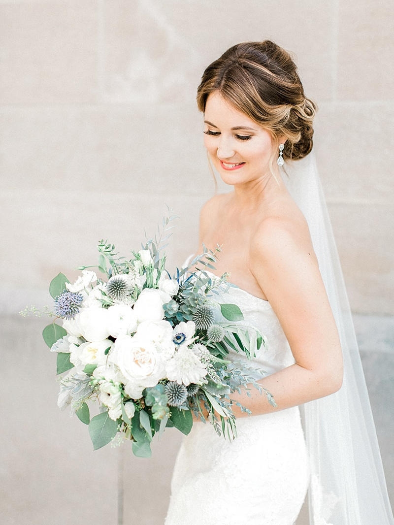 Classic bride with strapless white dress and textured bridal bouquet filled with garden roses and anemones
