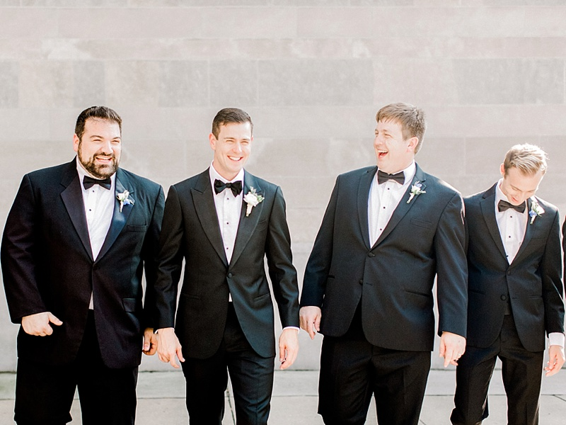 Groom and groomsmen in classic black tie tuxedos for a summer wedding at Chrysler Museum of Art in Virginia