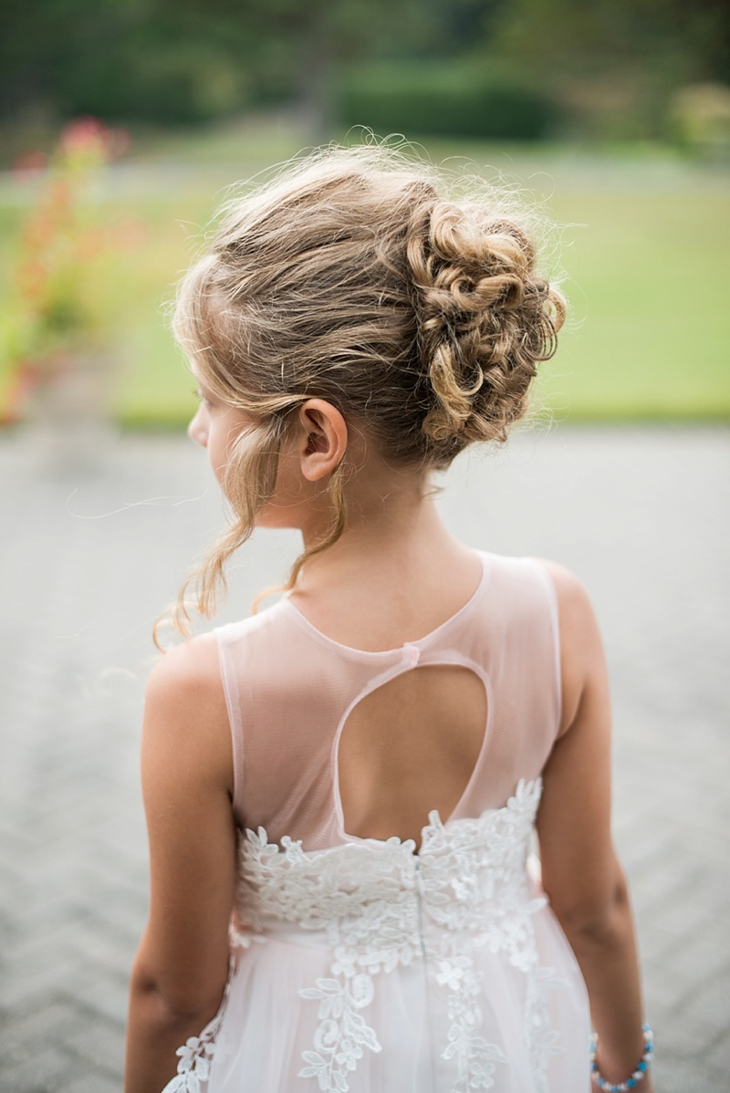 Adorable flower girl curled updo for a cute wedding hairstyle