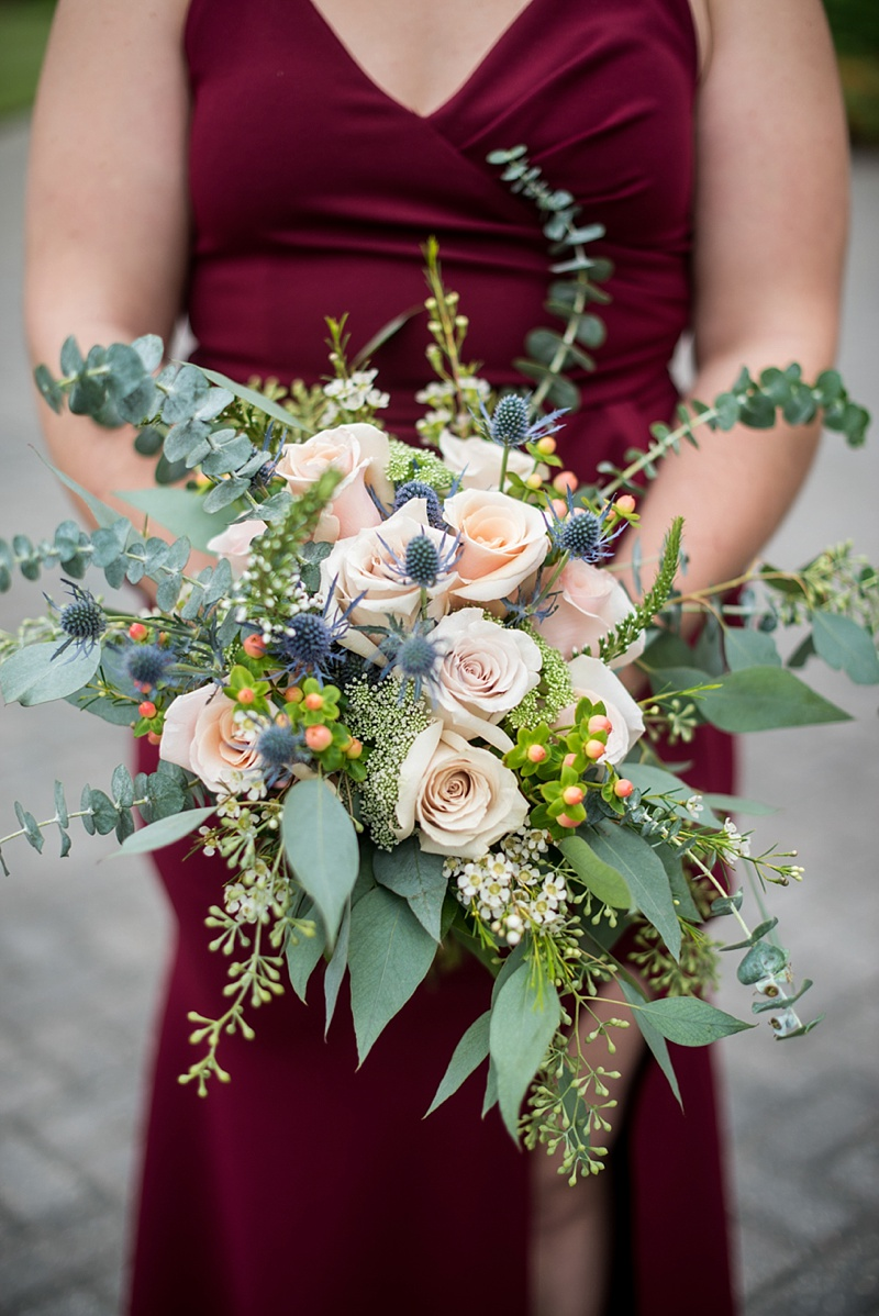 Textured bridesmaid bouquet with eucalyptus and berries for fall wedding