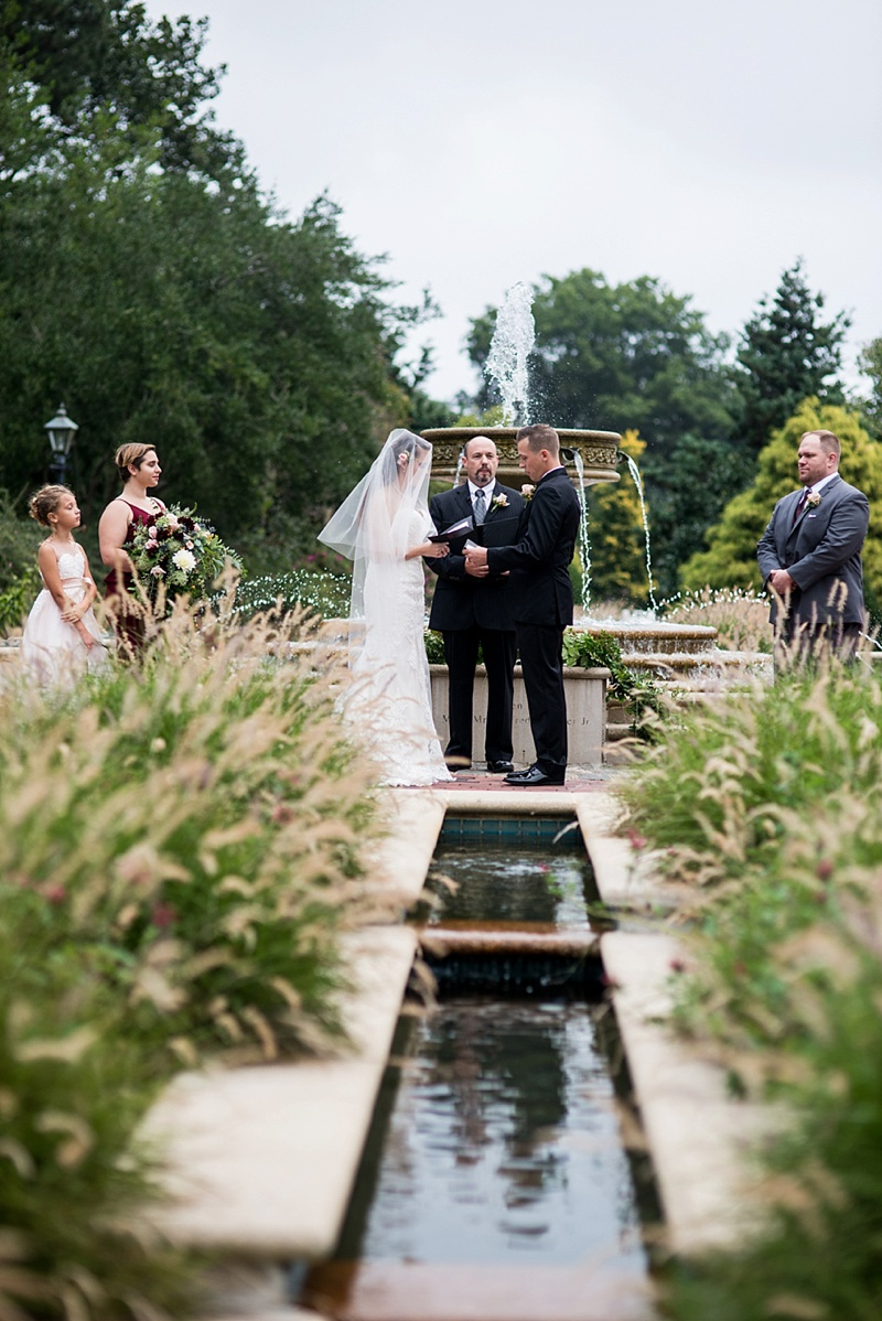 Garden wedding ceremony in front of water fountain at Norfolk Botanical Garden in Virginia