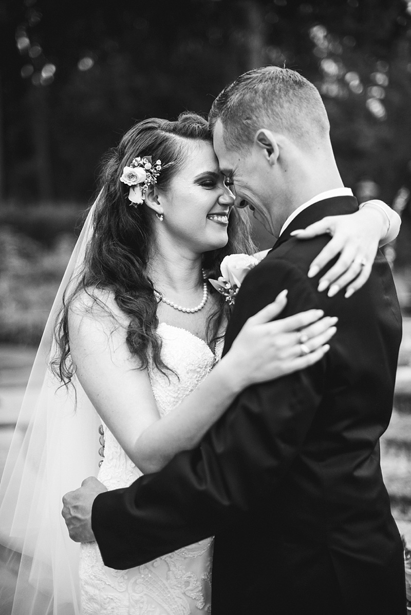 Classic rustic wedding moment between bride and groom at Norfolk Botanical Garden
